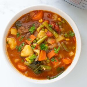 Instant Pot vegetable beef soup in a bowl.