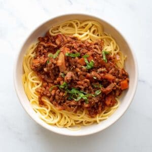 Slow cooker bolognese with spaghetti.