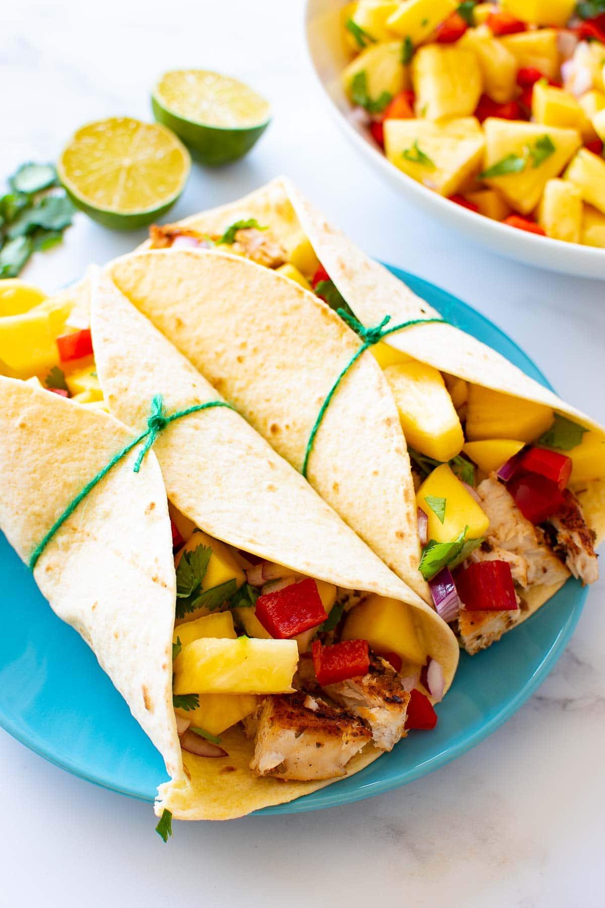 Tacos with blackened swordfish and mango pineapple salsa.