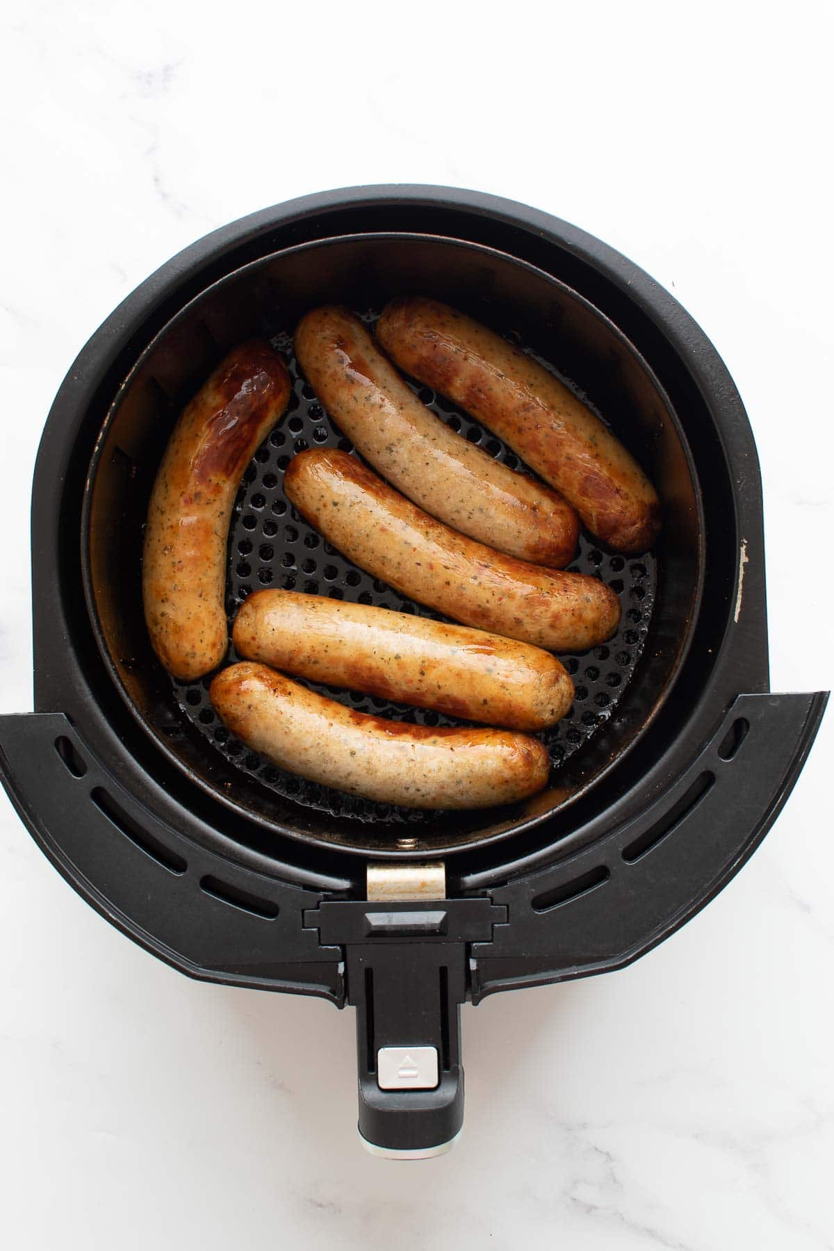 Cooked brats in an air fryer.