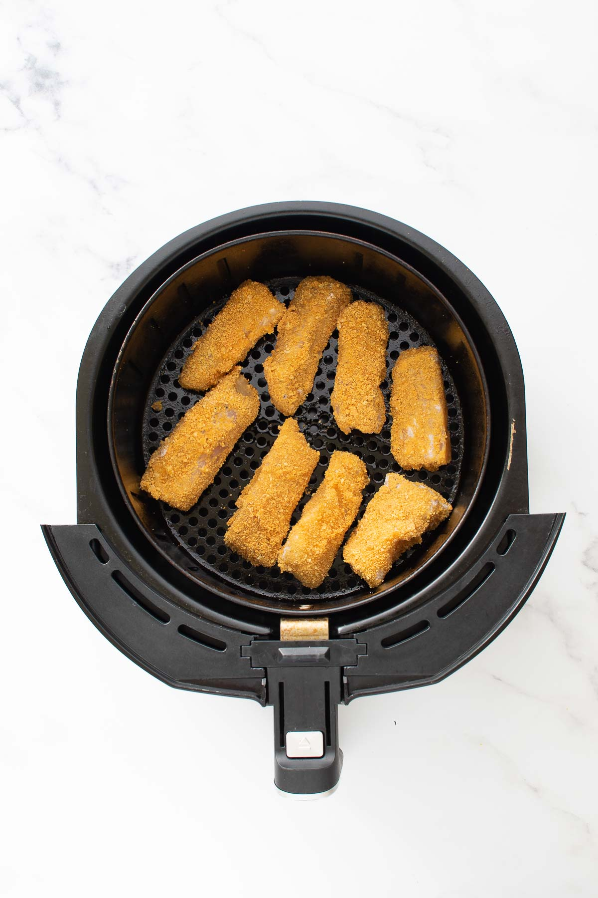 Fish sticks in an air fryer.