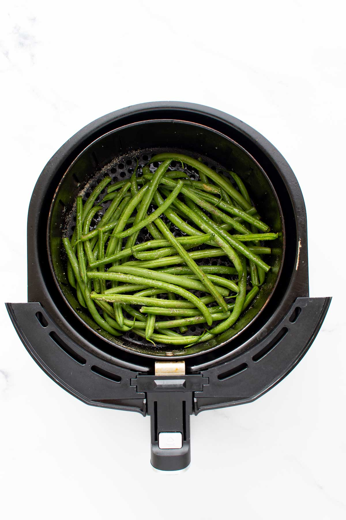Raw green beans in air fryer.