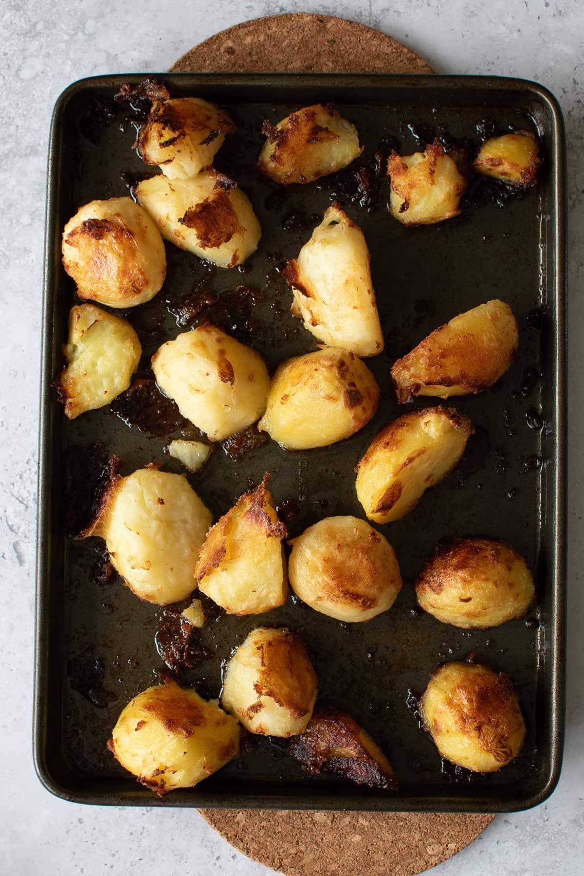 Roast potatoes on a sheet pan.