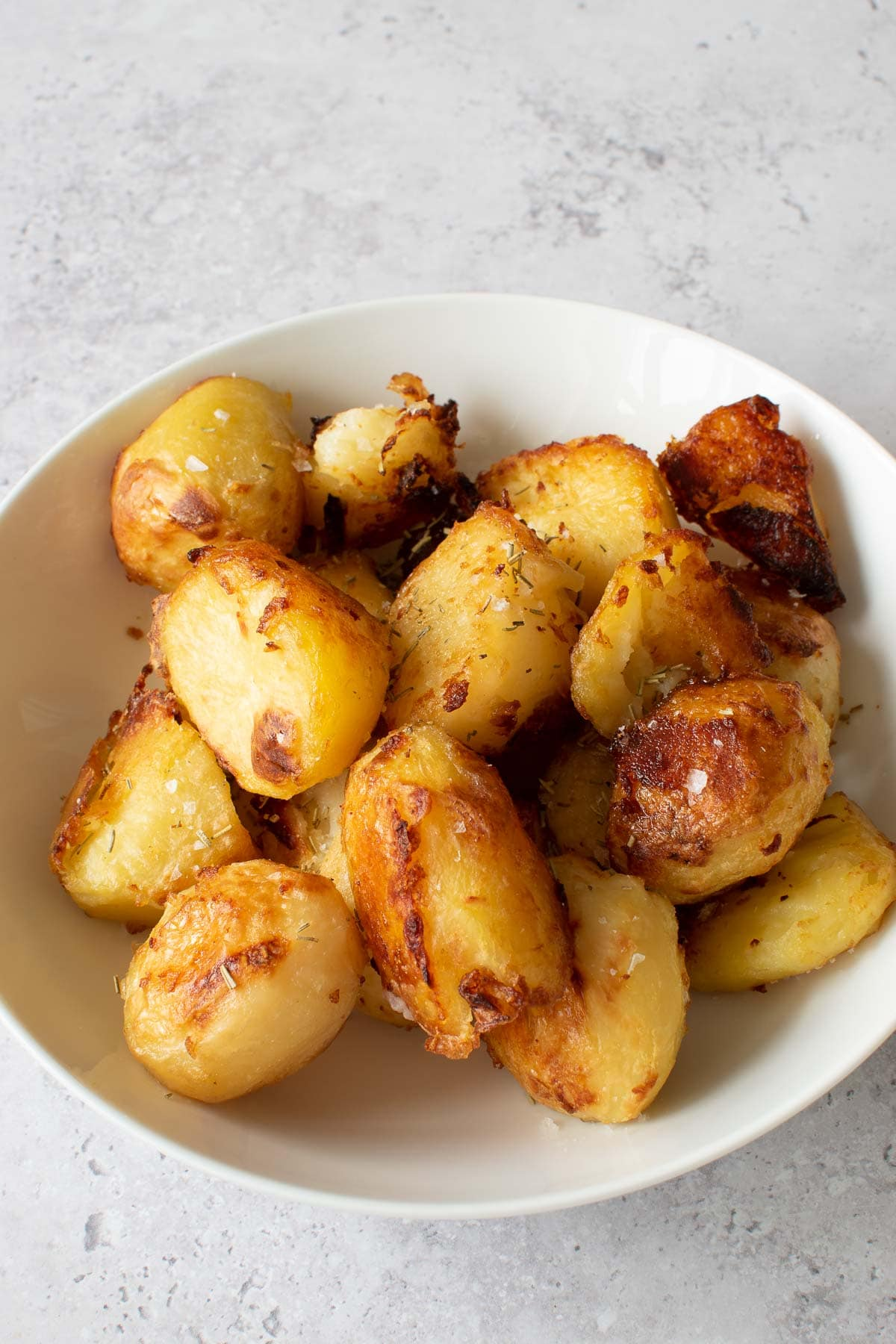 Rosemary roasted potatoes in a bowl.