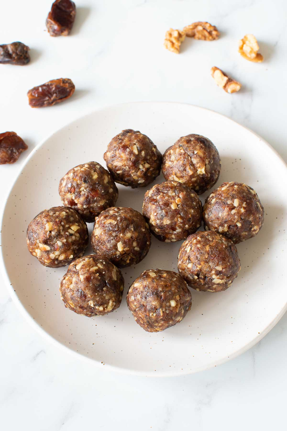 Date walnut balls on a plate.