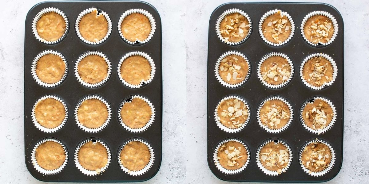 Uncooked muffins in a muffin pan, some topped with diced nuts.