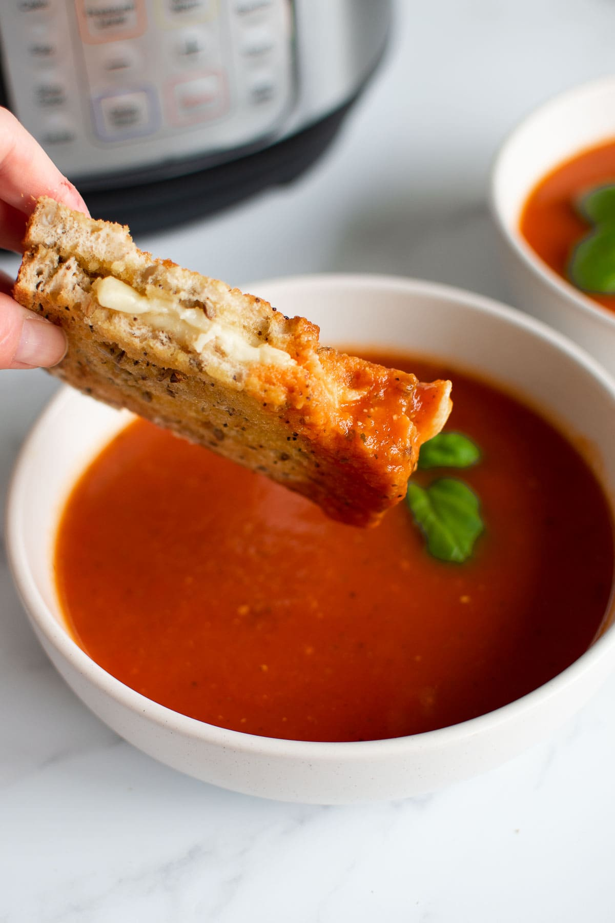 Grilled cheese sandwich dipped in tomato soup.