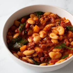 Butter bean and chorizo stew with spinach in a bowl.