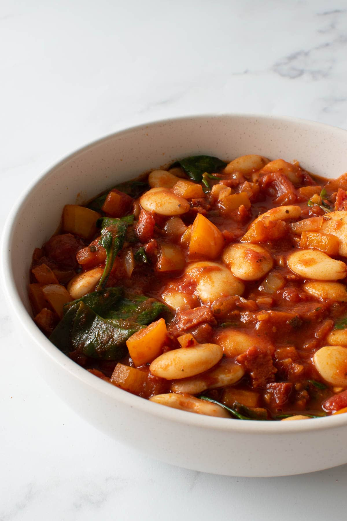 A bowl of butter bean stew with chorizo.