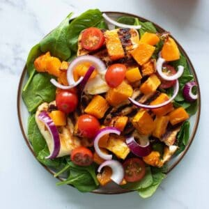 Halloumi and butternut squash salad on a plate.
