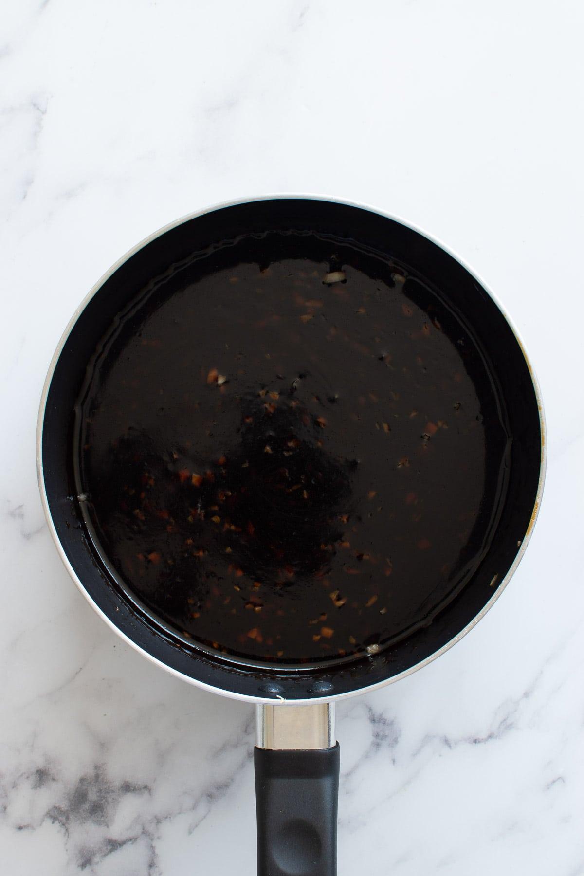 Cooking teriyaki sauce in a pot.