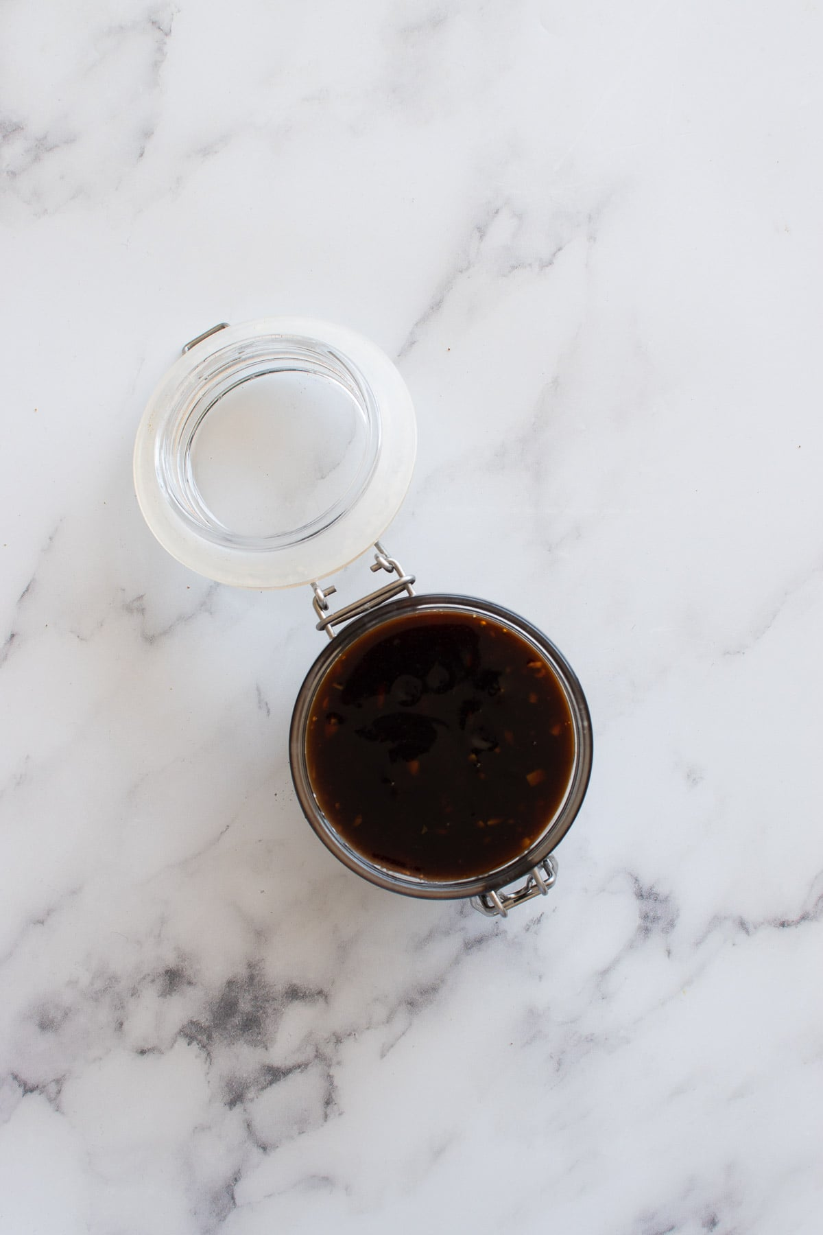 A sealed jar with homemade teriyaki sauce.