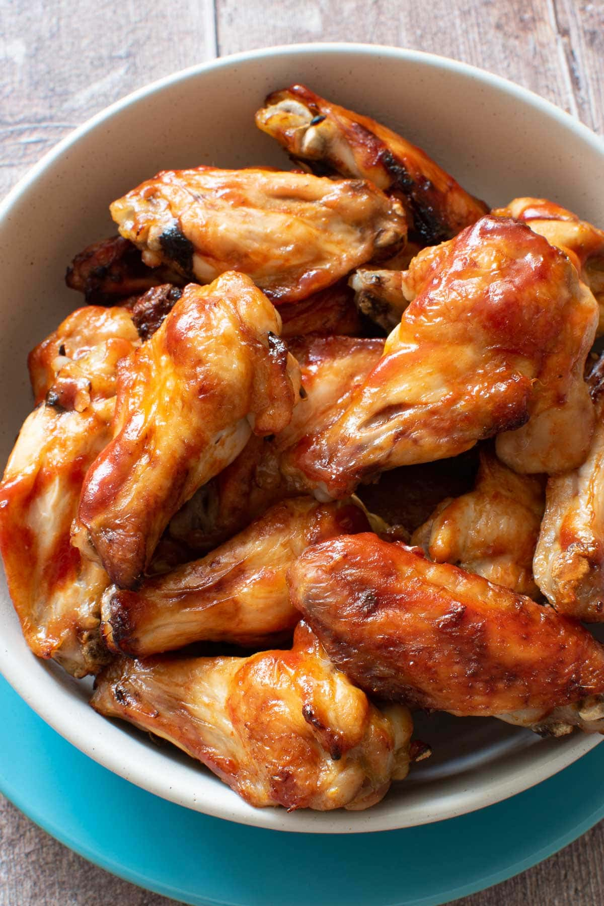 Close up of baked honey and sriracha chicken wings.