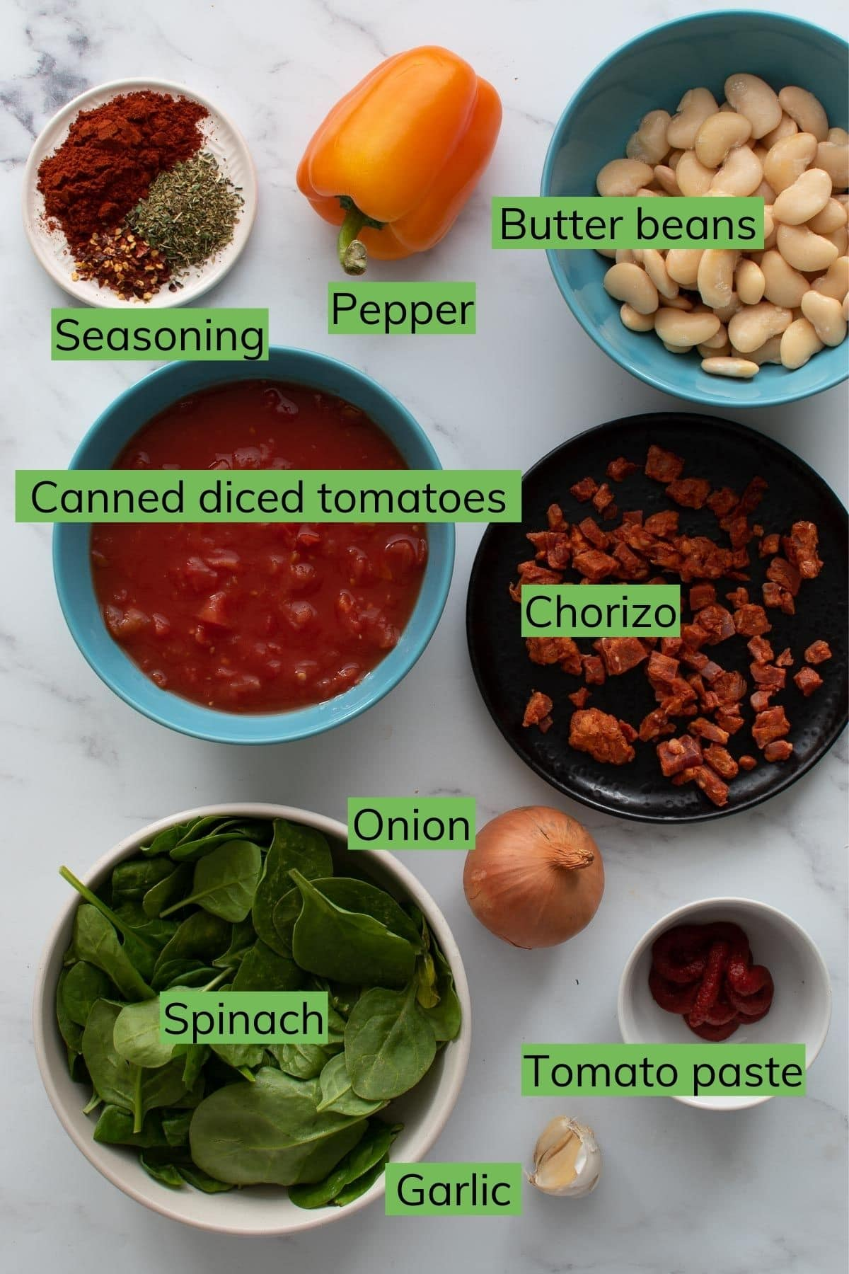 Ingredients needed to make chorizo butter bean stew.