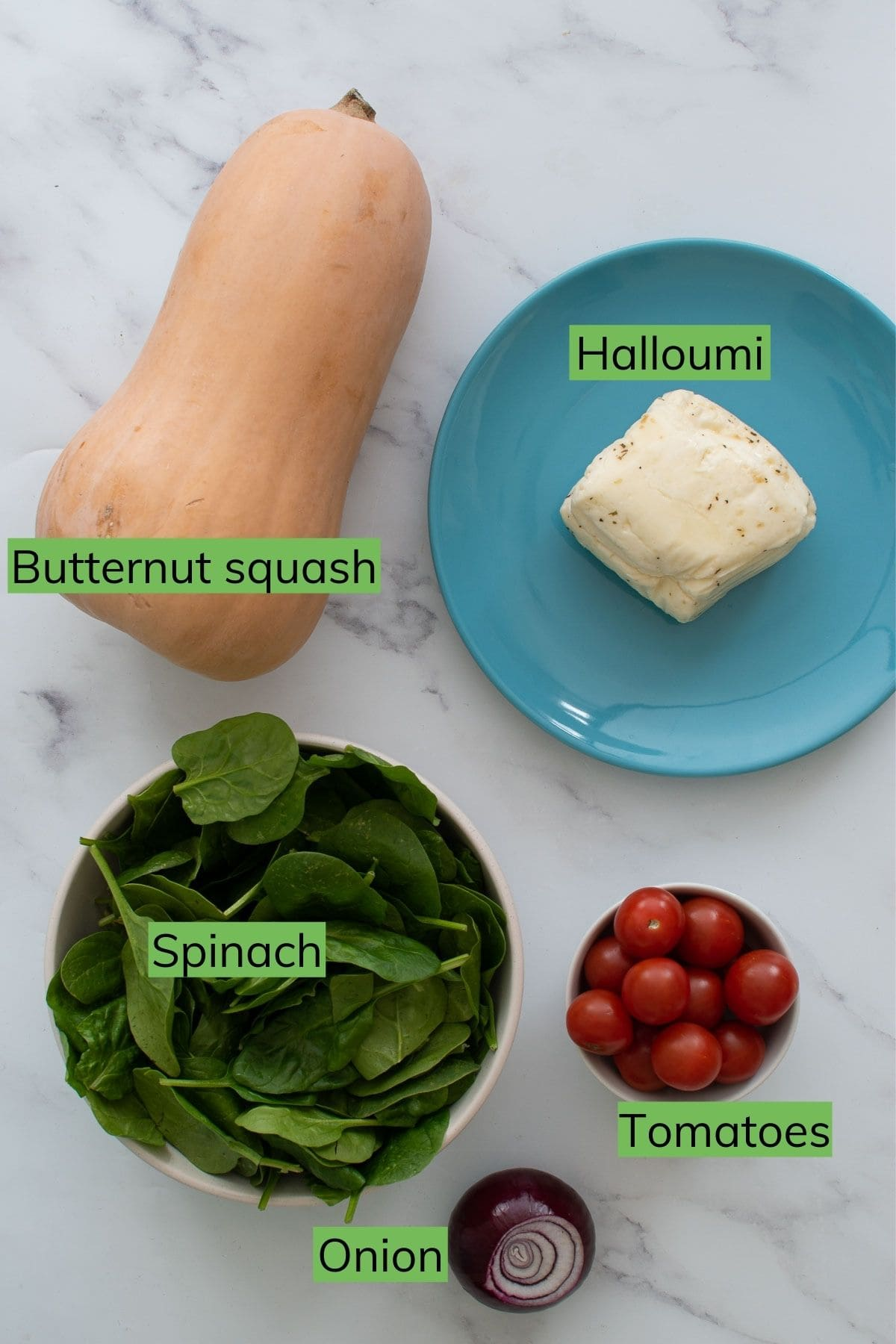 Ingredients for halloumi salad with butternut squash, spinach and tomatoes.