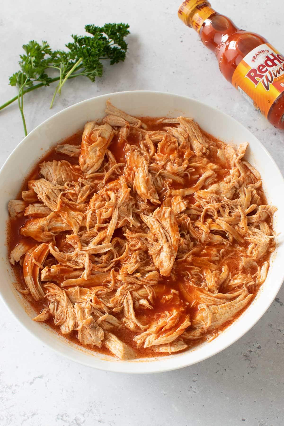A bowl of shredded buffalo chicken.