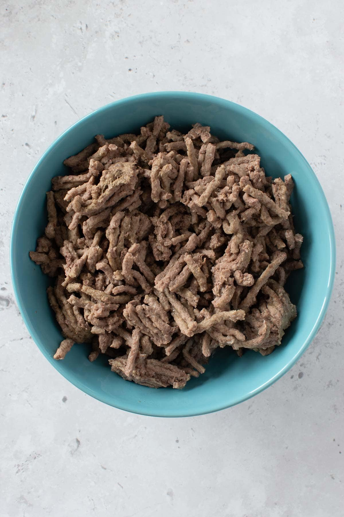 A bowl of pressure cooked ground beef.