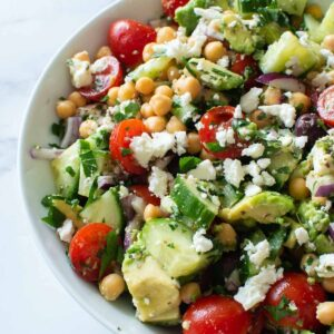 Salad with avocado, chickpeas, feta and tomatoes.