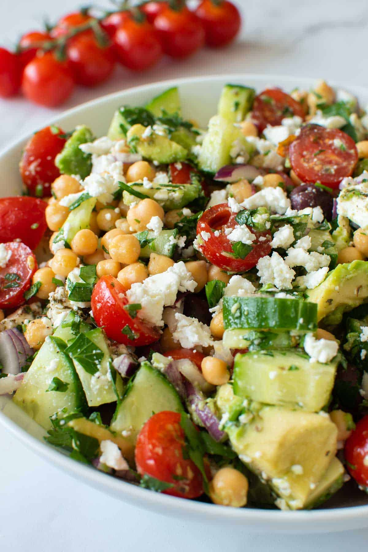 Close up of an avocado chickpea salad with vegetables.