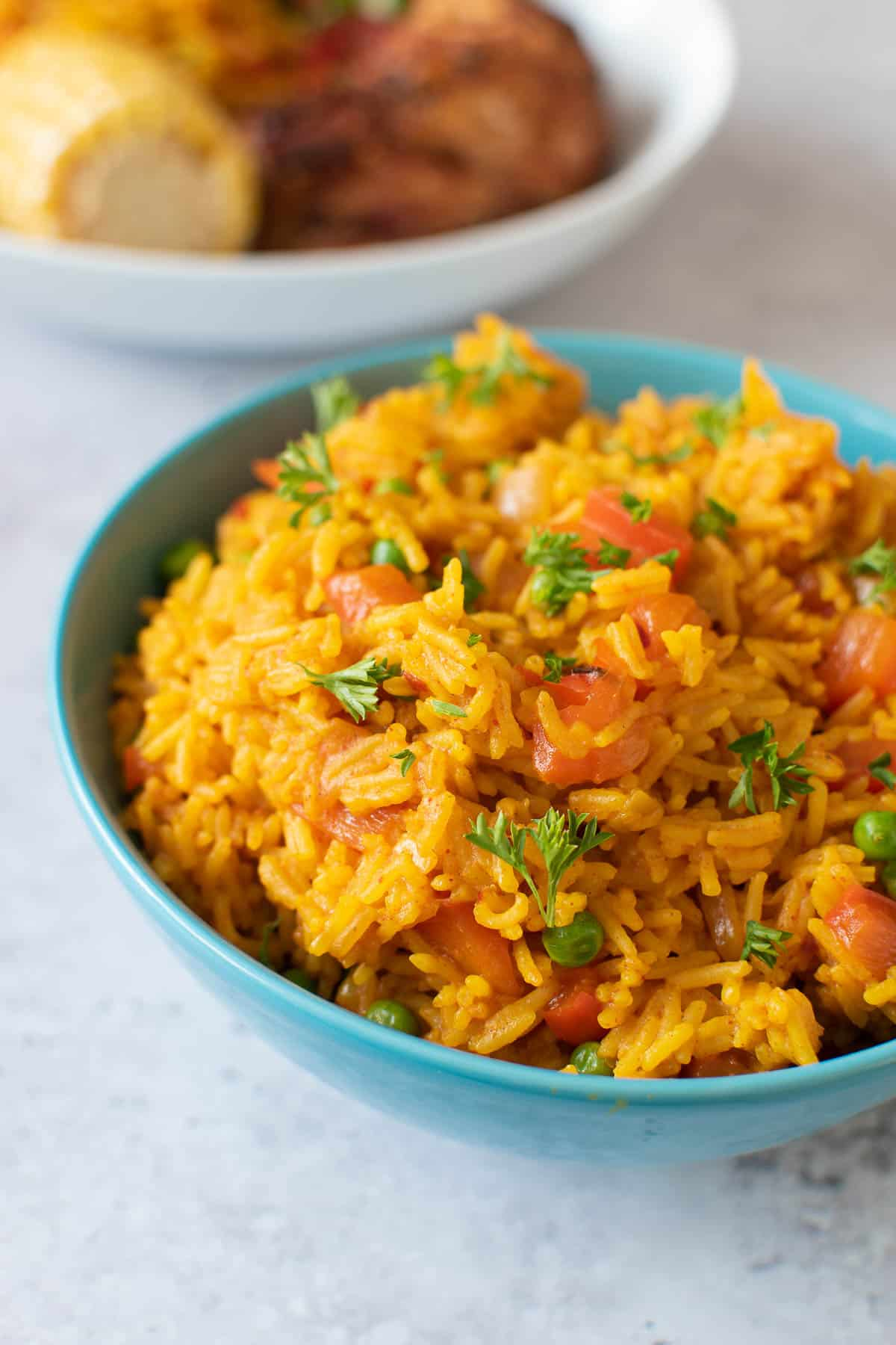 A bowl of nandos yellow rice with chicken.
