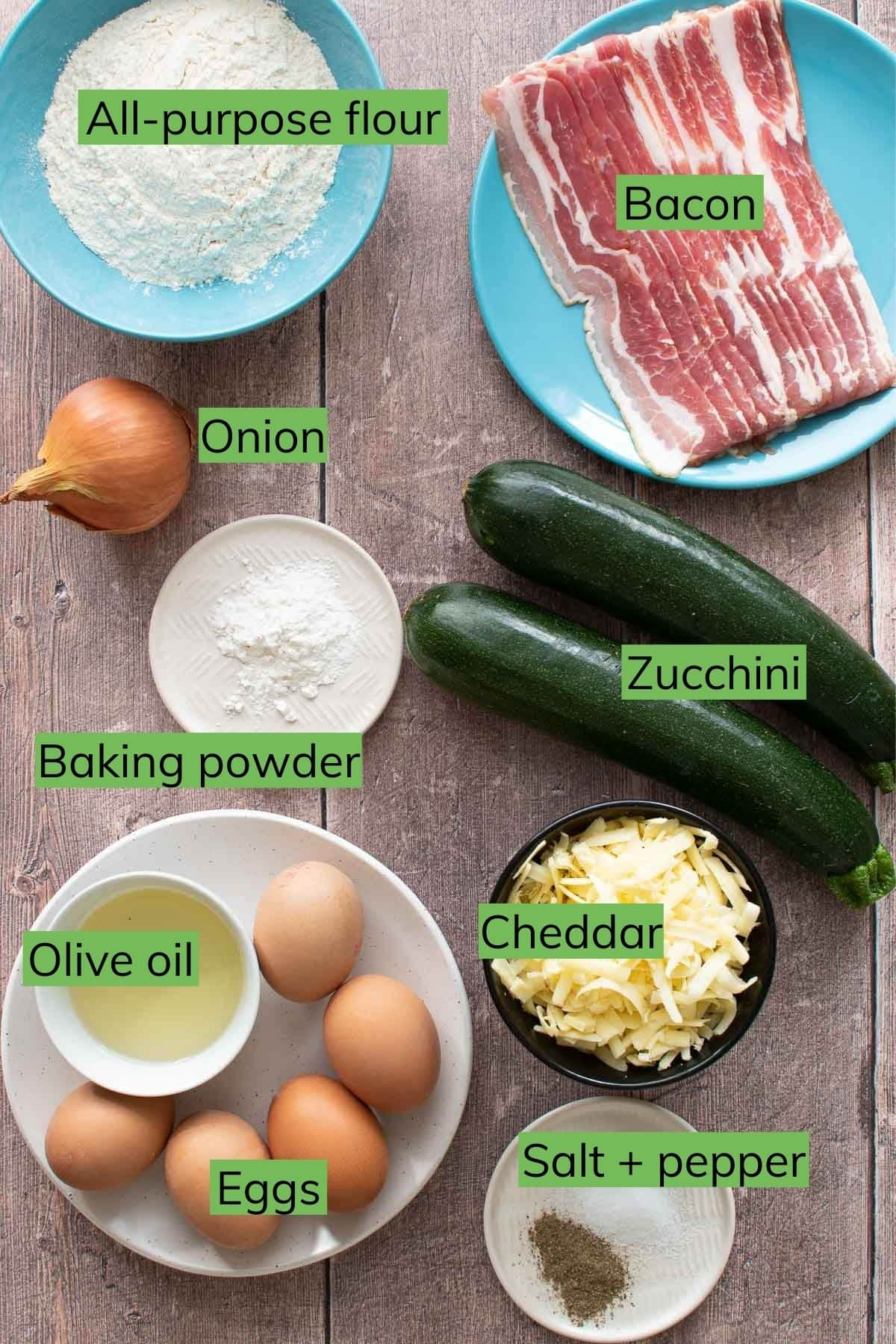 Ingredients needed to make zucchini slice laid out on a table.