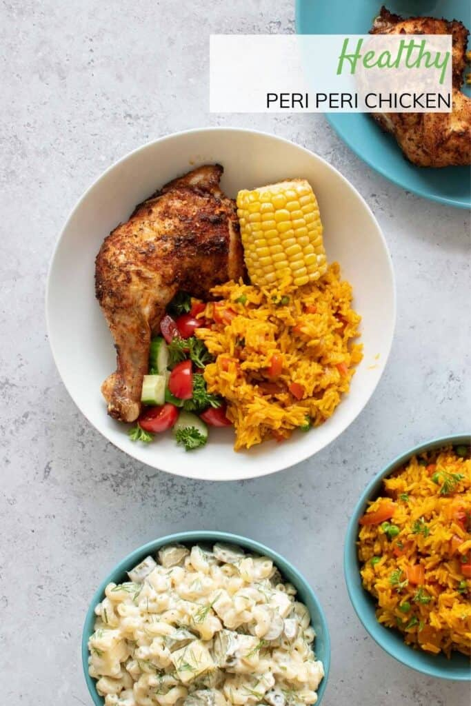 A bowl of baked peri peri chicken with sides.
