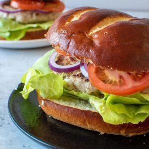 Close up of a pork and apple burger.