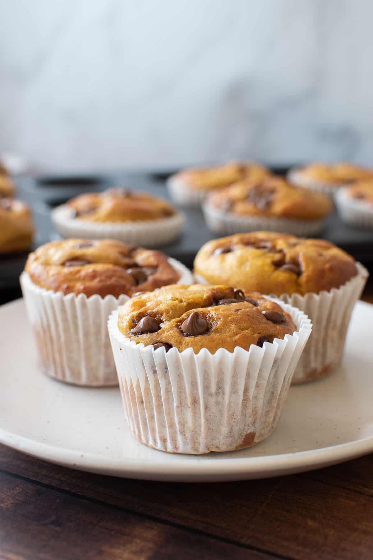 Pumpkin muffins on a plate.