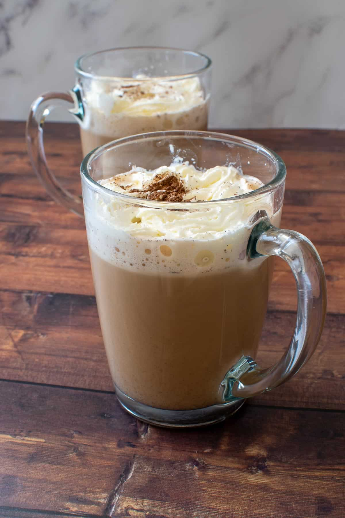 Glasses of latte with cream.