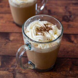 A cup of pumpkin spice latte with whipped cream.