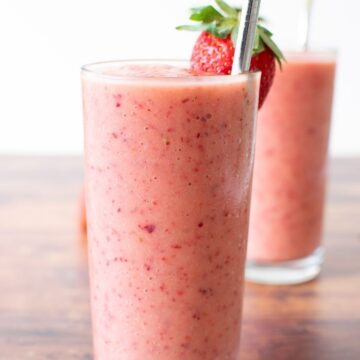 Close up of a pink strawberry peach smoothie.