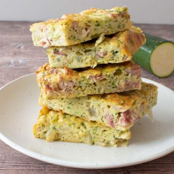Stacked zucchini slices on a plate.