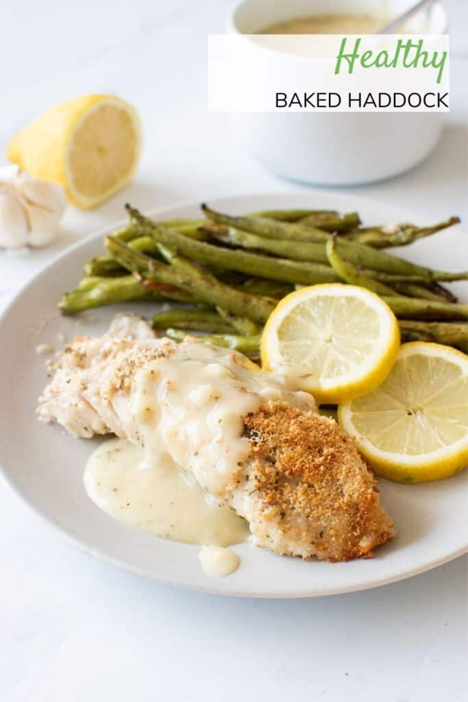 Baked haddock with lemon sauce and green beans.