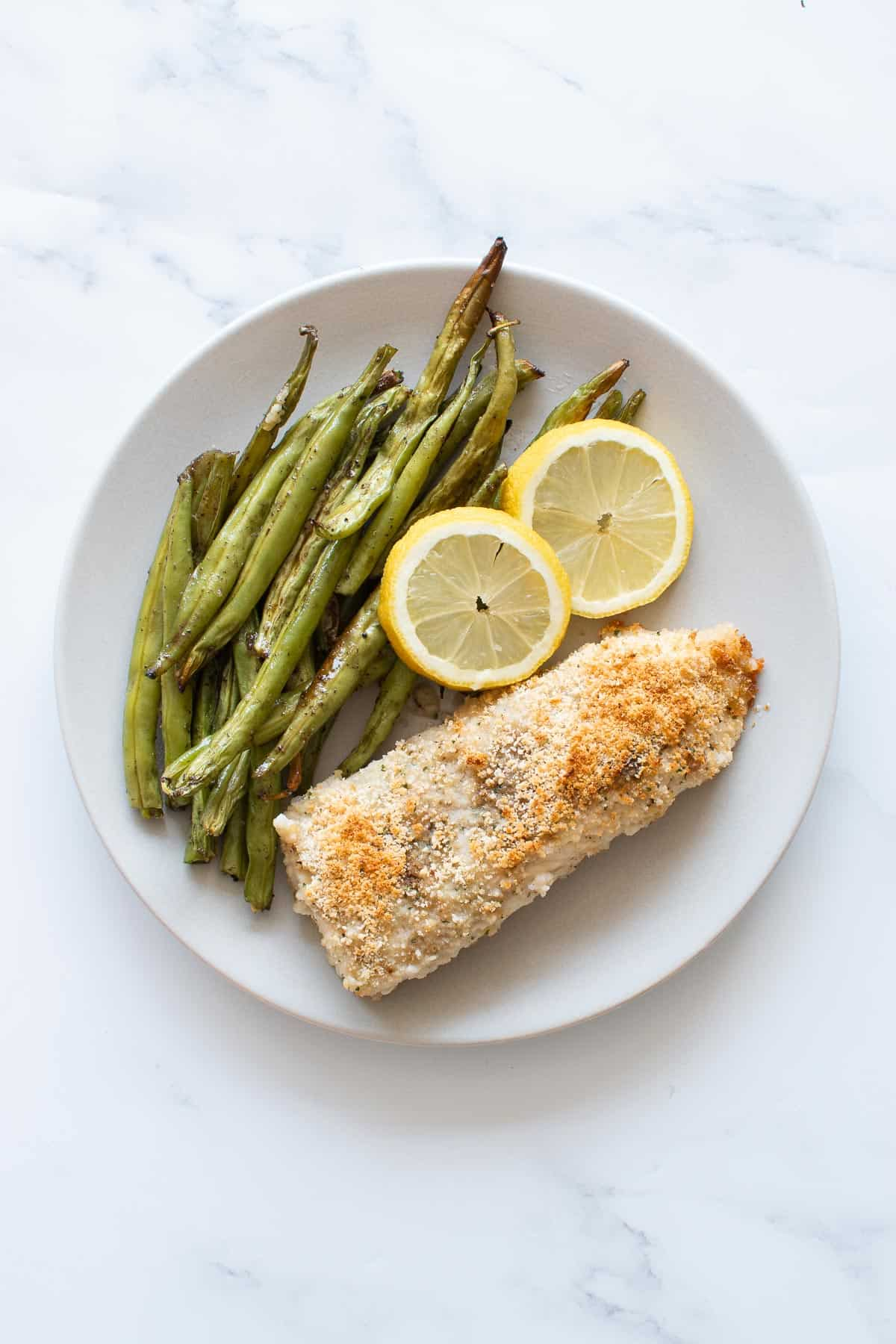 Baked haddock with lemon and green beans.
