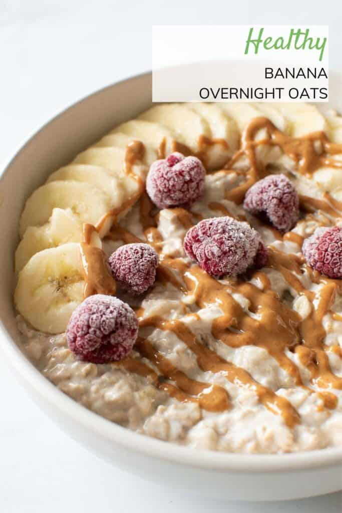 A bowl of overnight oats with bananas, peanut butter and raspberry.