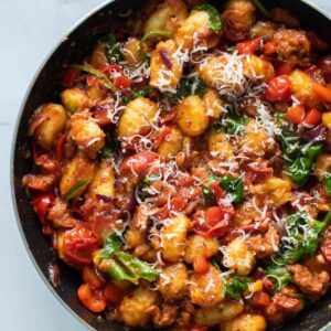 Chorizo gnocchi in a skillet.
