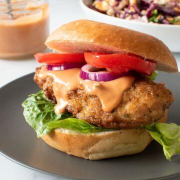Crispy chicken burger with burger sauce.