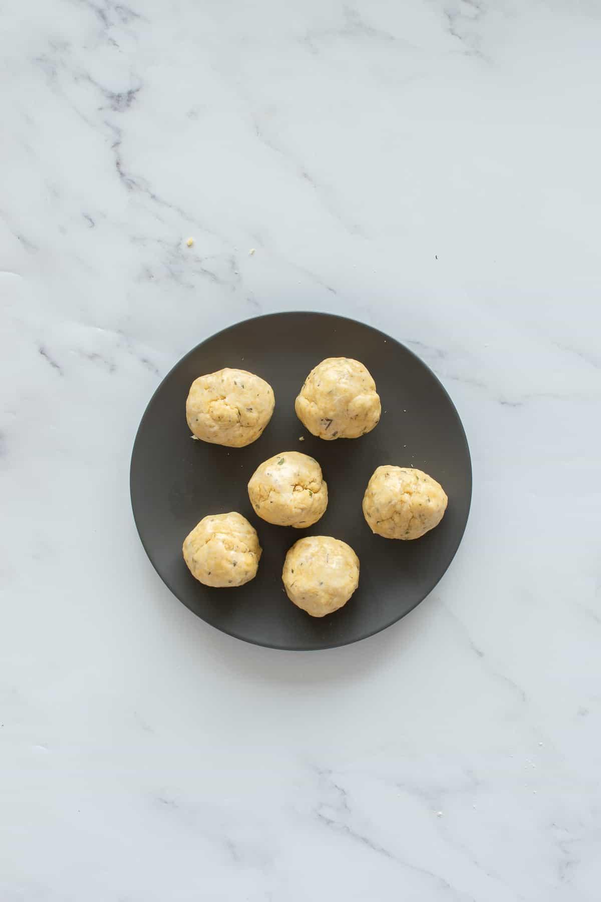 Raw dumplings on a plate.