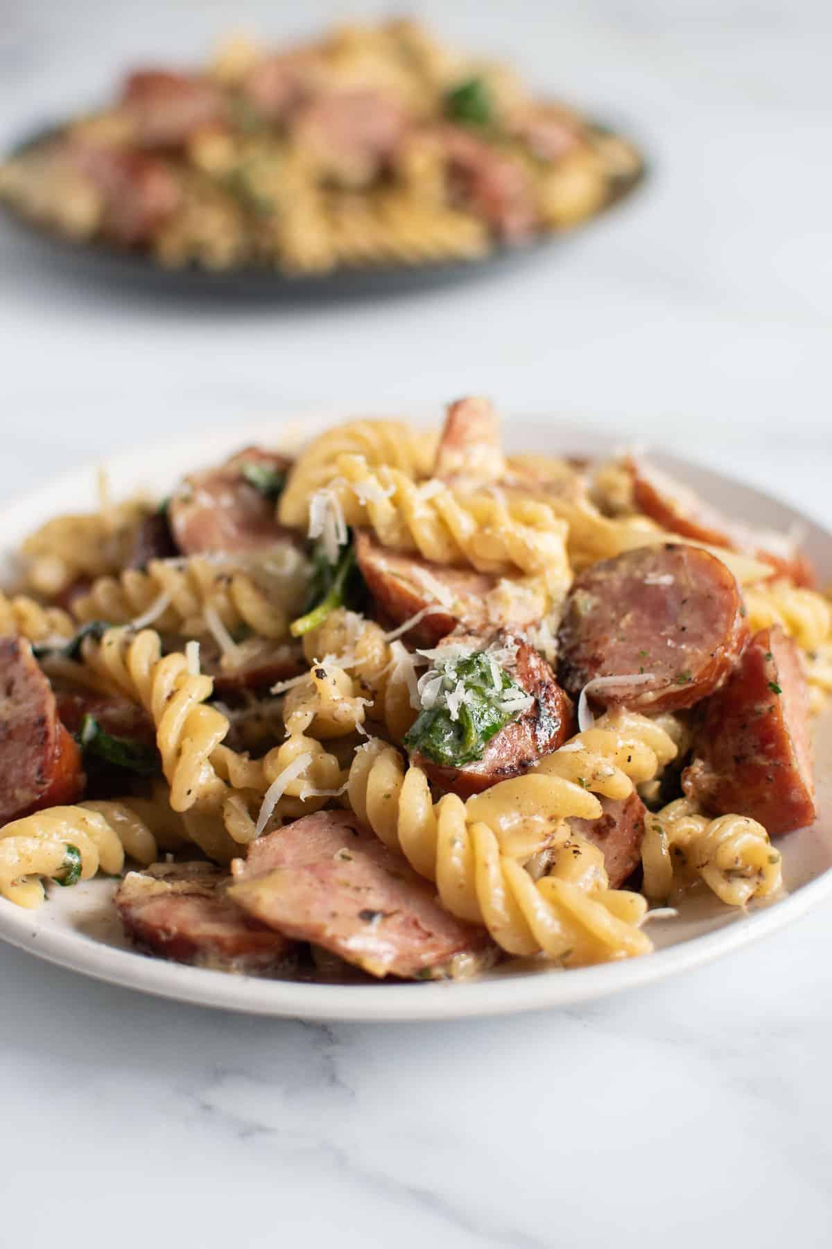 Close up of a plate of kielbasa pasta.