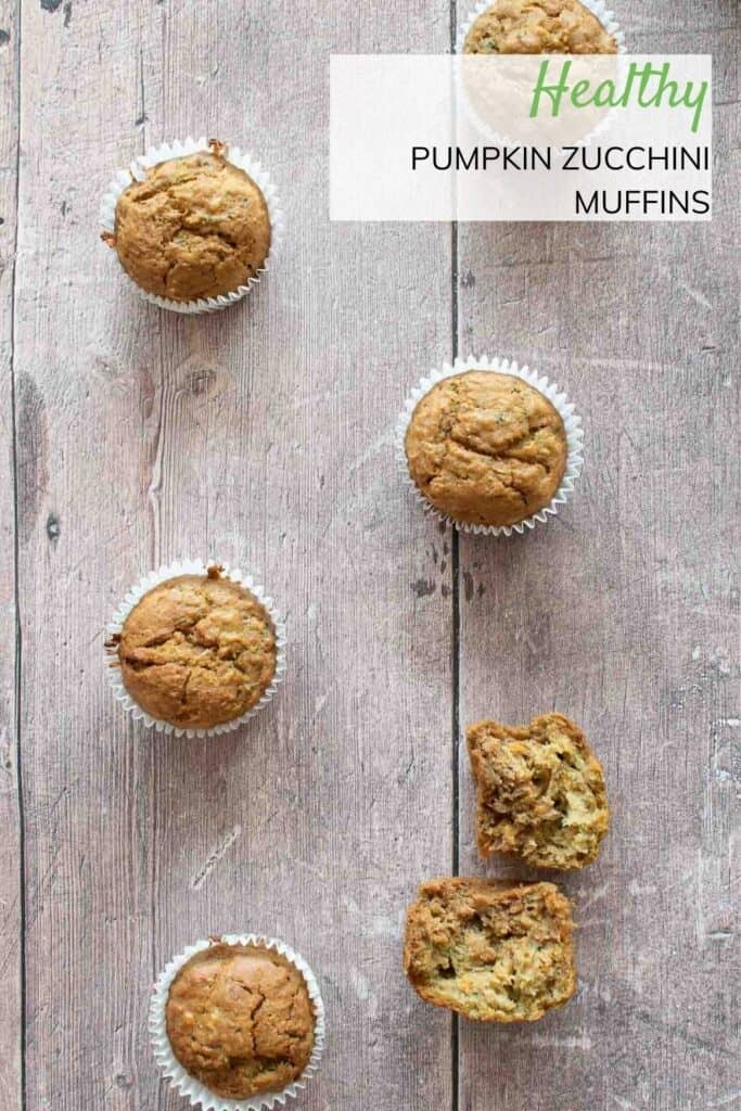 Zucchini and pumpkin muffins on a table.