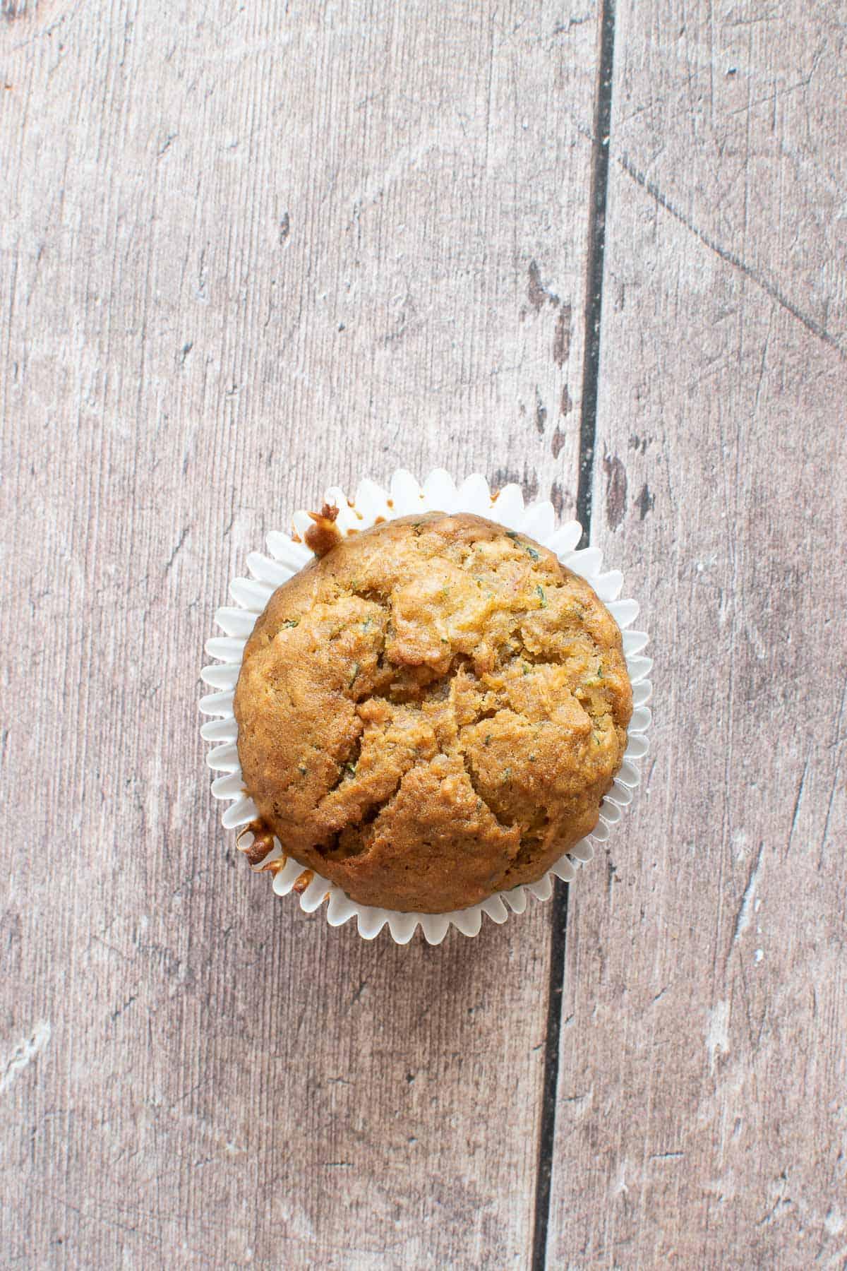 Close up of a pumpkin muffin with zucchini.