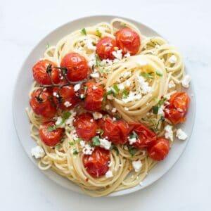 Spaghetti with roasted cherry tomatoes, feta and basil.