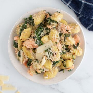 Salmon gnocchi with spinach and Parmesan cheese.