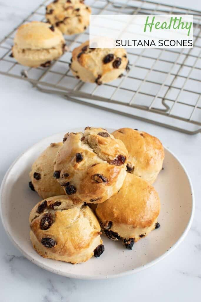 Scones with sultanas on a plate.