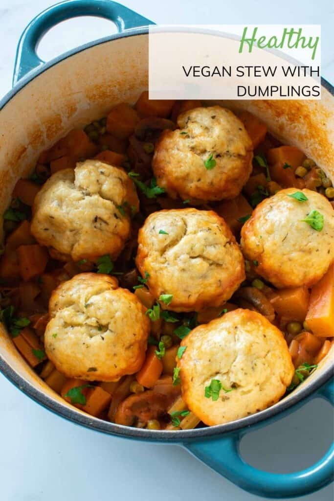 A pot of vegan stew with dumplings.