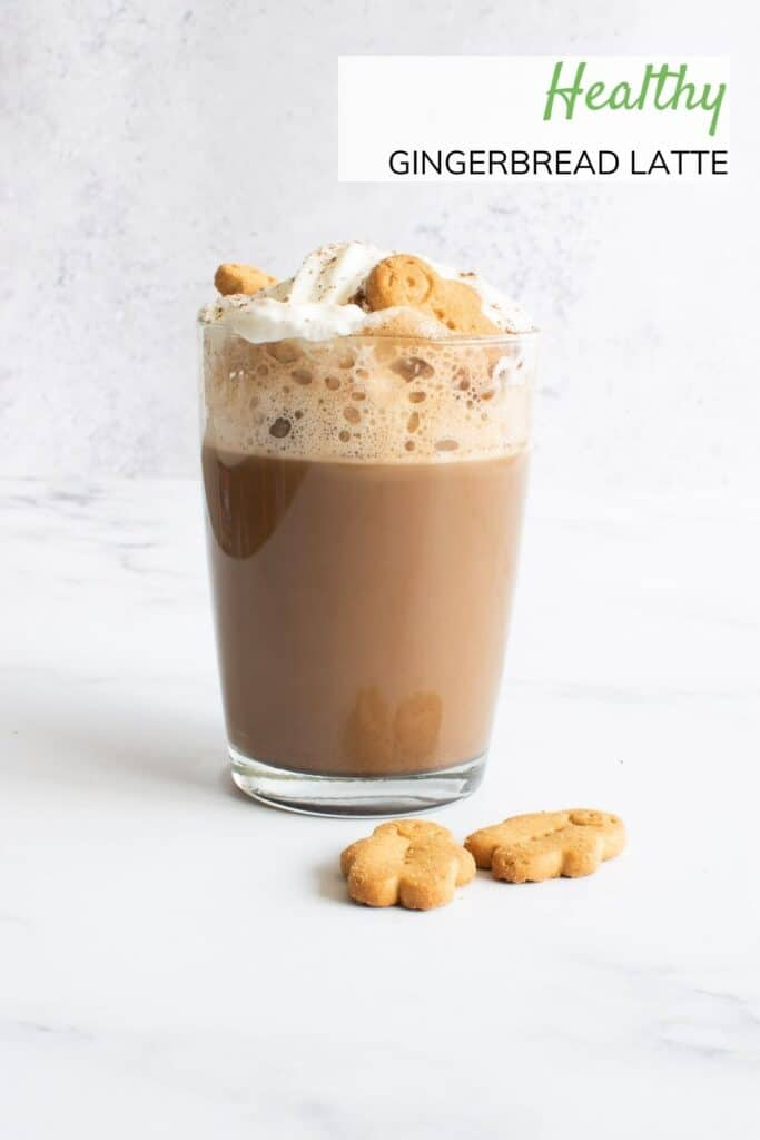 A glass of latte with gingerbread.