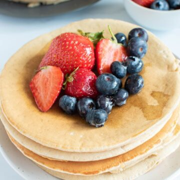 Oat milk pancakes with blueberries and strawberries.