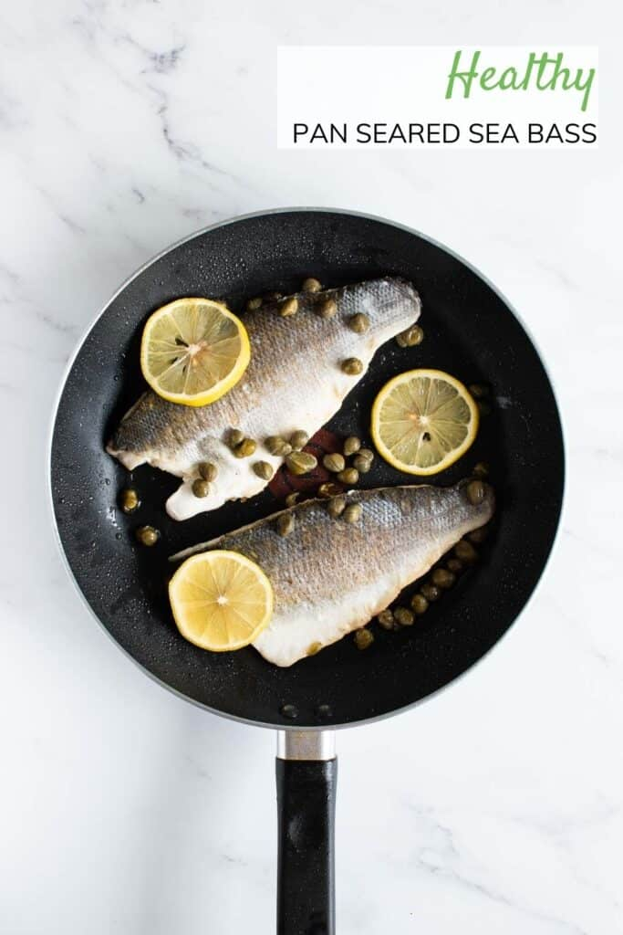 Sea bass, lemon and capers in frying pan.