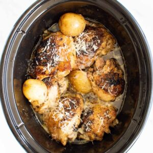 Slow cooker garlic Parmesan chicken and potatoes.