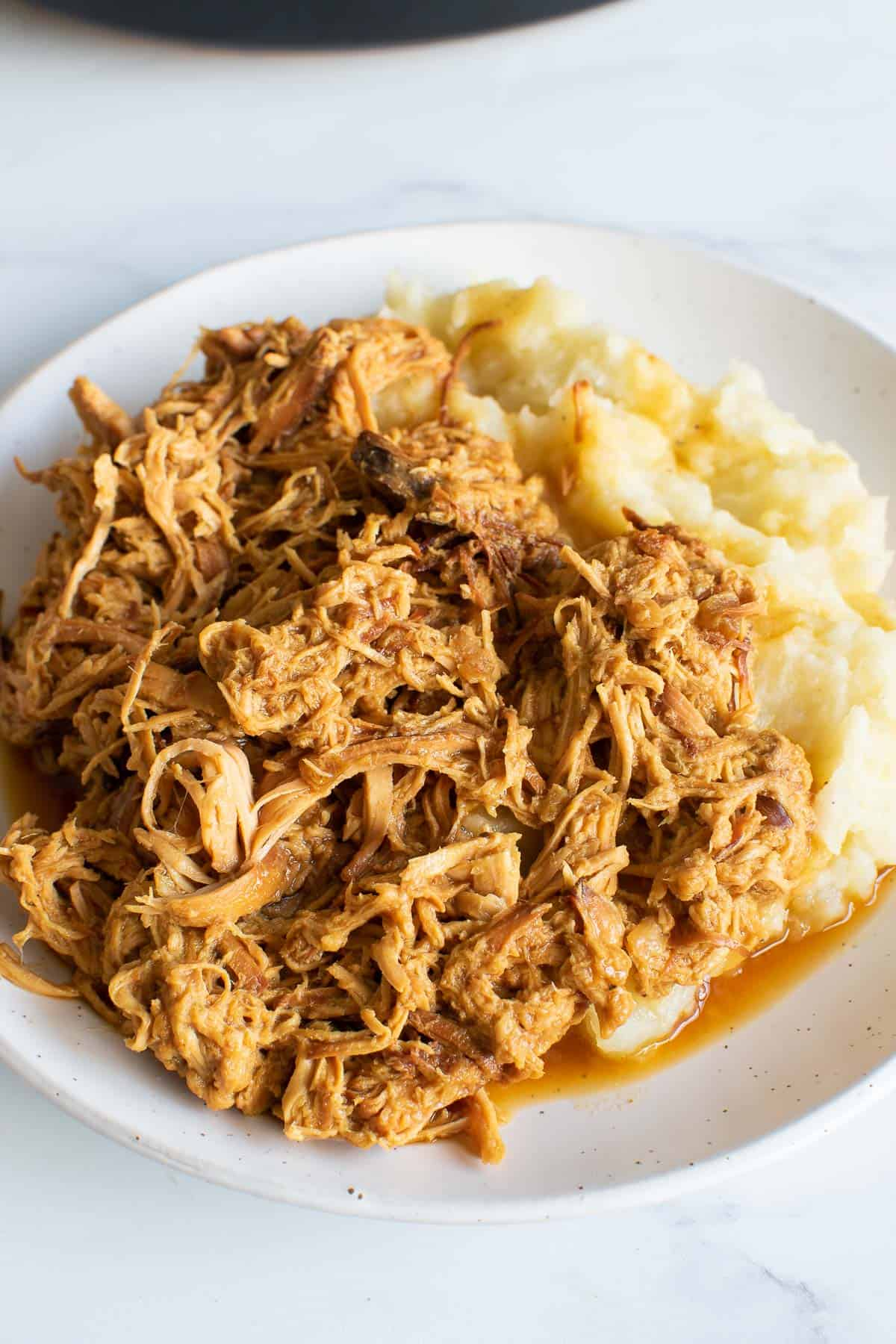 Shredded honey mustard chicken with mashed potatoes.